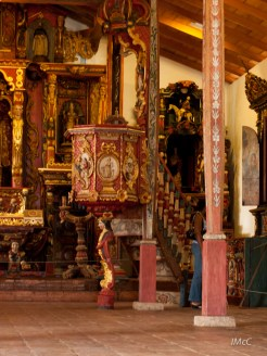 Inside a historical church in the province of Veraguas - no benches, and very intricate, hand-carved pillars, statues, and more