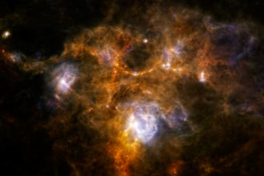 The Herschel Space Observatory has uncovered a weird ring of dusty material while obtaining one of the sharpest scans to date of a huge cloud of gas and dust, called NGC 7538.