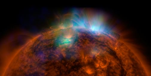 X-rays stream off the sun in this first picture of the sun, overlaid on a picture taken by NASA's Solar Dynamics Observatory (SDO), taken by NASA's NuSTAR. The field of view covers the west limb of the sun.