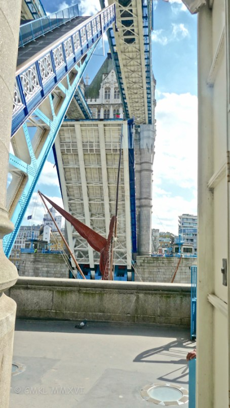 """Watching the Thames sailing barge """"Thistle"""" pass through the raised bascules."""