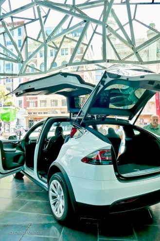 The newest Tesla on display under the glass roof of the Atrium
