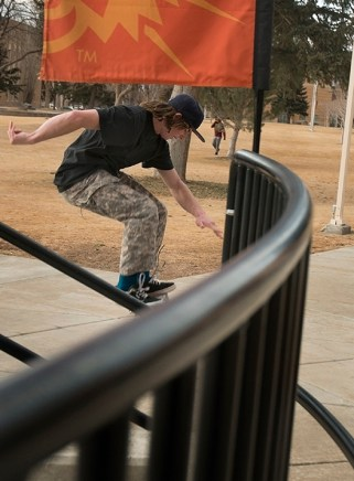 Skateboarder Ian Brown, 19, aciddrops off the stairs near the entrance to the Pond Student Union Building, Thursday, Jan. 30, 2014, in Pocatello, Idaho. Brown stated he recently moved from Arco, Idaho to live near the ISU campus. (ISU Photo/Terry Ownby)
