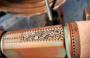Laulima Antiqued Copper Coated and engraved  Titanium malihini  flashlgiht
