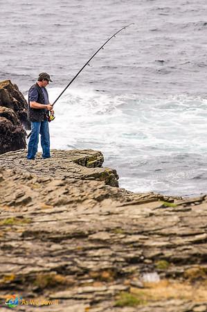 Irish fishing at the cliffs on Loop Head Drive