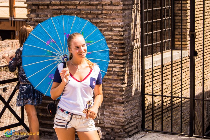 Woman poses with a paper umbrella; that must have been a really large drink!