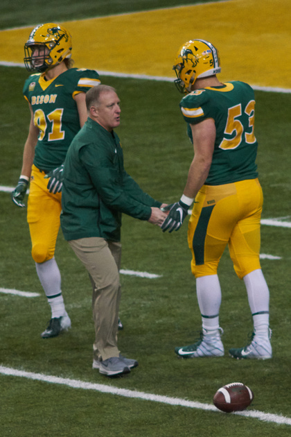 NDSU Head Coach, Chris Klieman greats DE #91 in the north end-zone. -<small>Photo DSC05216 by Craig Maas</small>