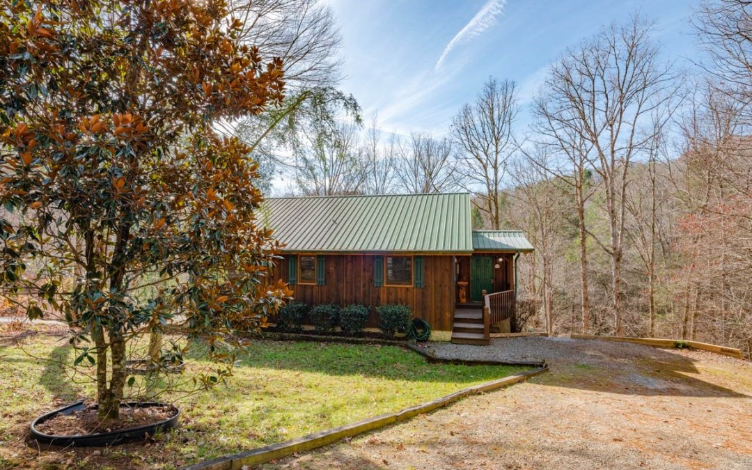 This delightful 2BR/2BA Fightingtown Creekfront Cabin sits perched on 2.01 acres above the creek for viewing the glistening, rushing waterfront perfection roaring across the mountain boulders below. The cabins inviting interior with cozy mountain décor includes a spacious open floor plan of one level living with cathedral ceiling, a combination of tongue & groove & drywall, hardwood floors, tankless water heater, custom kitchen cabinets & island, 2 master suites, attractive stacked stone gas log fireplace in the spacious living room that merges with the sunny sunroom for relaxing & enjoying the mesmerizing creek music below in a picture perfect setting with 100ft of gentle waterfront access to slide right into your very own trout oasis.