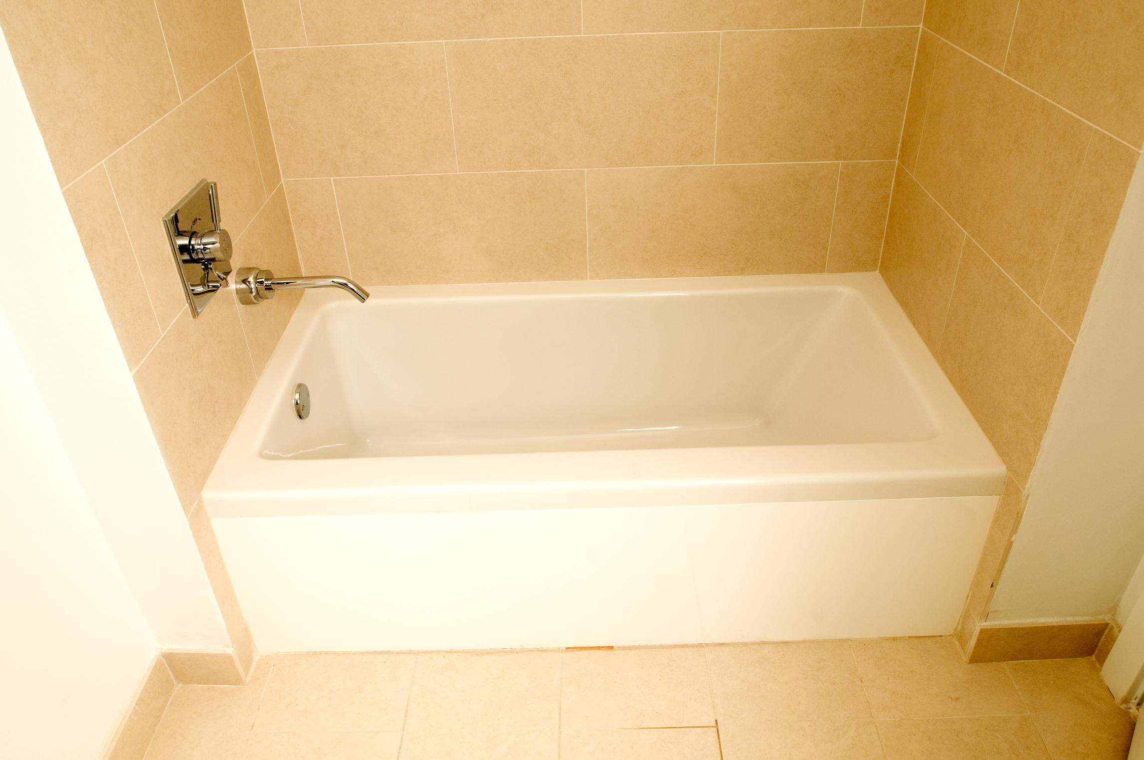 https homeguides sfgate com replace faucet handles spout old tub 26199 html
