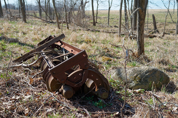 Spotted rusty farm equipment sporadically along the trail.