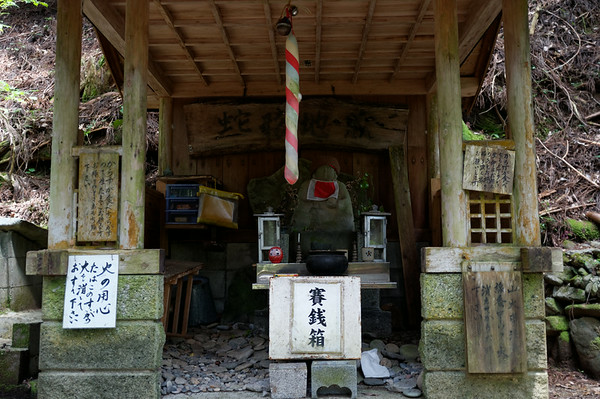 I didn't understand all the signage but tribute was often offered by travellers to these jizo statues.