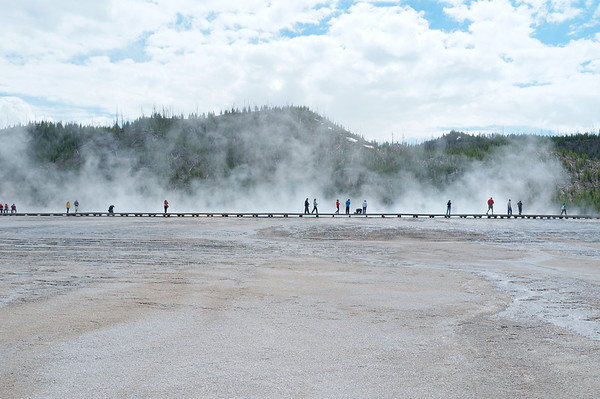 Tourists checking out the geyser in Yellowstone National Park
