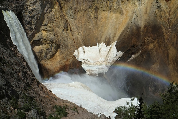 Waterfall and rainbow in Yellowstone National Park