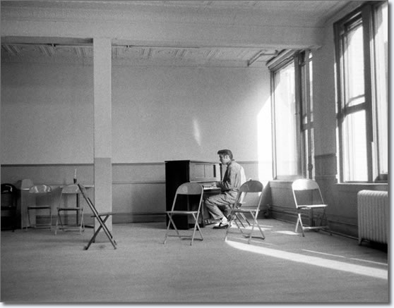 Elvis Presley sitting alone at a piano singing and playing gospel music - March 17, 1956