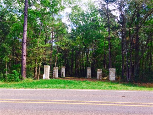 21 acres - check out this pretty entrance leading to that perfect place to build your new home!  The property is wooded, has beautiful trees, and the owner has hauled dirt in to make a building pad.  Great location - close in!  Give us a call!