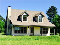 3/2 Farm Home on Wooded 10 Acre Tract! Built in 2011 - never lived in!  Upgrades include soaring ceilings, pretty rock fireplace, nice tile flooring, kitchen w/ granite counter tops and stainless appliances.  Master Suite down has gorgeous bath with tile shower, oversized tub, double sinks and closet with built-ins. Pretty wrought iron stairway leads to 2 bedrooms and full bath upstairs.  Zoned central ac/heat, tankless hot water heater and foam insulation. Owner reports lots of wildlife!