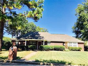 3/2 brick in Enchanted Estates, neat as a pin and in great condition! Spacious open living and dining, double pane windows, split floor plan with two guest bedrooms that share a hall bath, study/home office that could be a formal dining room, and large country kitchen. Private, spacious master suite with two walk-in closets and full bath.  Handy laundry room off the kitchen with good storage. Garage off the back of home w/concrete drive! Come see this energy efficient home!