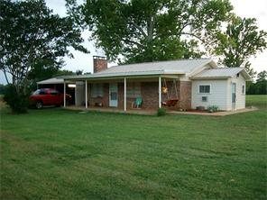 Great location! This cozy two bedroom, one bath home sits on 9.43 acres. The living room has a fireplace with inserts. Outdoors you will find a detached 2-Car carport and a 40' X 50' barn with a 12' X 12' storage underneath. The property is fenced and there is a fenced pasture for horses with a small shed. Come see! This could be the place for you!