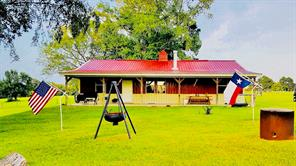 WELCOME TO THE FARM! This secluded property gives you peaceful country living with all the updates for comfort. From the moment you pull in the drive, you will be impressed with the pretty setting. The home sits nestled under shades trees with a welcoming front porch. The 2 bedroom, 1.5 bath home has an open floor plan with corner rock fireplace. The bar divides the kitchen area. The kitchen has pretty oak cabinets. The two nice size bedrooms share a full bath. The handy laundry room off of the kitchen has access to the half bath and a very nice 20x22 shop/garage. For your guests, there are 2 RV hookups with 30 amp service. The property is completely fenced,  has good pasture, and the remaining back 30 acres is wooded. There is a creek on the property, 4-wheeler trails, pine, cedar, and hardwoods. The owner reports deer, hogs, coyotes, bobcats, and fox. This property has a lot to offer from peaceful country living, running a few horses or cattle, to hunting. Call today to view!