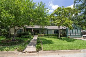 """This pretty 4 bedroom, 2 bath home has so much to offer. It's located on a quiet street close to downtown. This home has been lovingly maintained and is very spacious. The welcoming front porch leads you to a large living room with a fireplace and pretty wood floors. The country kitchen has good cabinet space, eat-in bar and large dining area. This home has lots of windows, bringing the gorgeous landscaped grounds inside. The main master has its own private sun-room, nice bedroom area, great bath, and his and her walk-in closets with built-ins. The convenient laundry is located off of the master suite. The second master suite is very large with it's own private bath. The two guest bedrooms have lots of space and share a full bath. The """"wow"""" in this property is when you walk in the backyard and see the mature landscaping, beautiful garden, and patio. Another bonus is the sprinkler system and dog kennel! Call us today for more details and to see this great home!"""