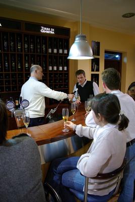 Maurizio Micciché pouring wine for us