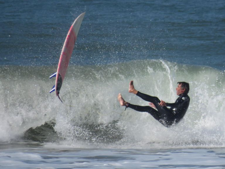 Surfer falling off his board
