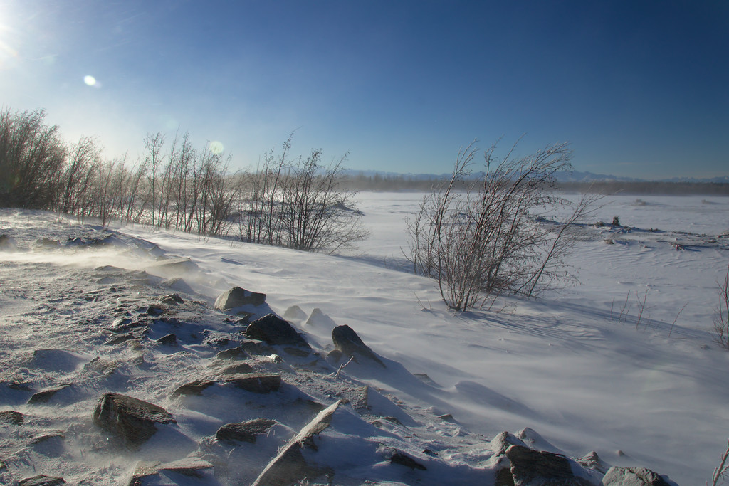 Wind blowing snow across the frozen Tanana River.
