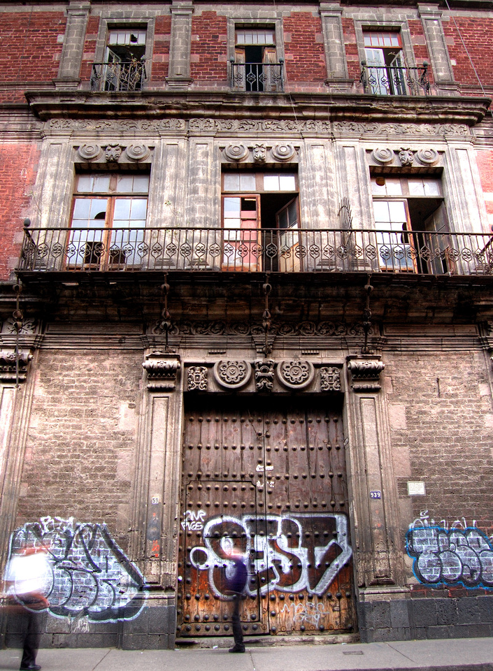 Urban Photographers - Graffiti Background - Graffiti on the door of a Spanish Colonial building in Mexico City, Mexico.
