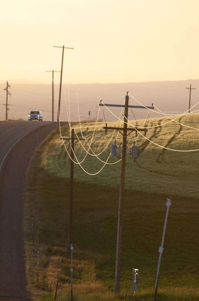Free pics: Power lines glisten at dusk along a rural road in Eastern Idaho, near the Teton Mountains.