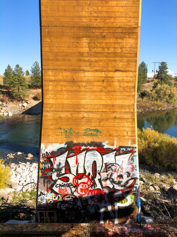 Run the Spokane River - Spokane Valley and the Centennial Trail - Graffiti on the train bridge near Sullivan Road and Indiana Avenue from the Centennial Trail near Spokane Valley, Washington.