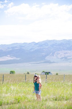 A mother and her young daughter walk the interpretive trail at Almo's Idaho State Park Visitor Center.