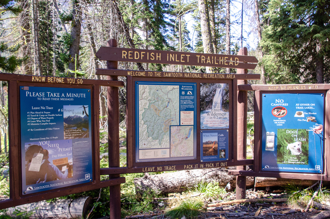 Best Baron Lakes Idaho Hikes - Grandjean Campground and Trailhead to Redfish Lake. A trailhead sign at the Redfish Lake Inlet Campground.