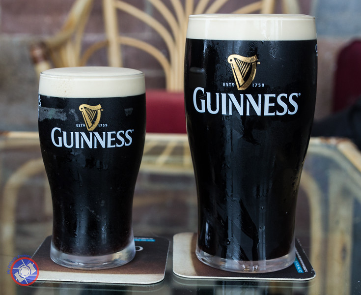 """A Perfect Pint of Guiness Alongside """"Mini-Me"""" a Very Rare Half Pint Replica (©simon@myeclecticimages.com)"""