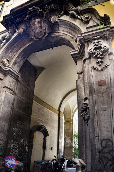 Entrance to a Grand Palazzi on Spaccanapoli Showing an Old Family Crest (©simon@myeclecticimages.com)