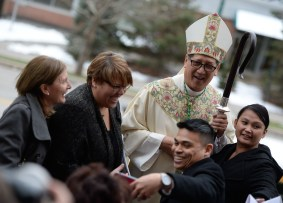 Francisco Kjolseth | The Salt Lake Tribune Congregation members crowd Bishop Oscar A. Solis as they pose for photographs following the installation ceremony at the Cathedral of the Madeleine on Tuesday, March 7, 2017.