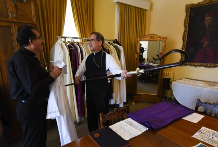 Francisco Kjolseth | The Salt Lake Tribune Deacon Guillermo Mendez speaks with Bishop Oscar A. Solis as he assembles his own staff during the vesting in the Glass Room prior to installation ceremonies at the Cathedral of the Madeleine on Tuesday, March 7, 2017.