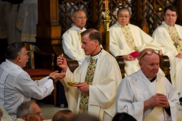 Francisco Kjolseth | The Salt Lake Tribune Archbishop John C. Wester gives communion during installation ceremonies of Bishop Oscar A. Solis at the Cathedral of the Madeleine on Tuesday, March 7, 2017.