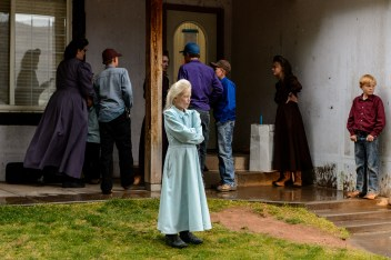 FLDS women and children stand outside of the Colorado City, Ariz., home they had just been evicted from, Tuesday May 9, 2017.