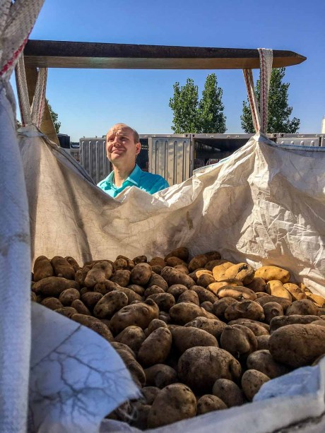 An FLDS woman unloads a ton of potatoes