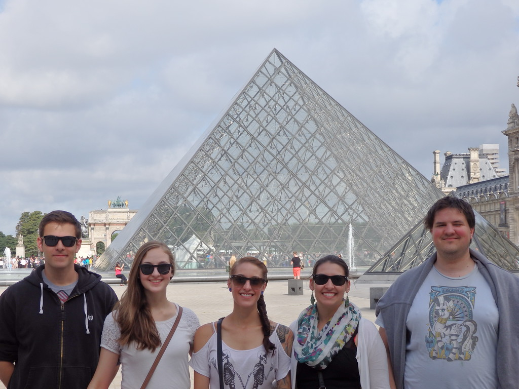 Me and My Siblings in Front of the Louvre Pyramids