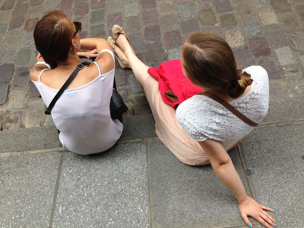 Jen and Michelle Resting Their Feet While Waiting for Crepes at Les Galandines in Paris, France