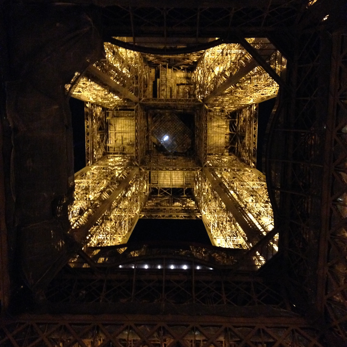 Looking Up into the Center of the Eiffel Tower at Night