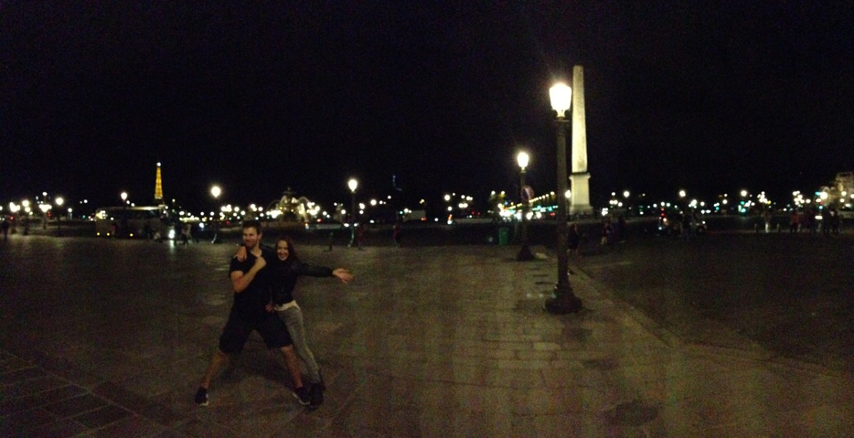 Jen and Jared Posing at the Place de la Concorde in Paris, With the Eiffel Tower in the Background