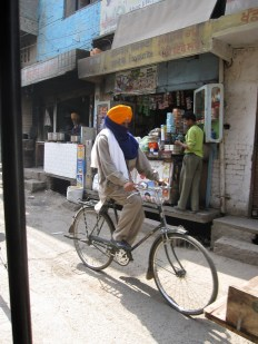 sikh man on a bicycle