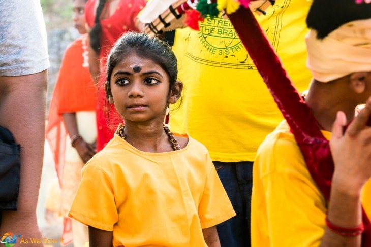 Young girl waiting to journey to Batu Caves