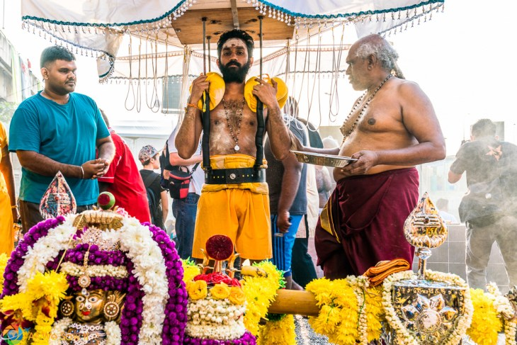 Carrying a burden for the journey to Batu Caves. Thaipusam 2017