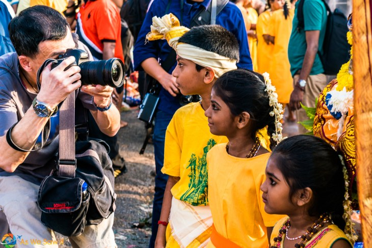 Shoving your lens into the face of a child is tasteless. Thaipusam 2017