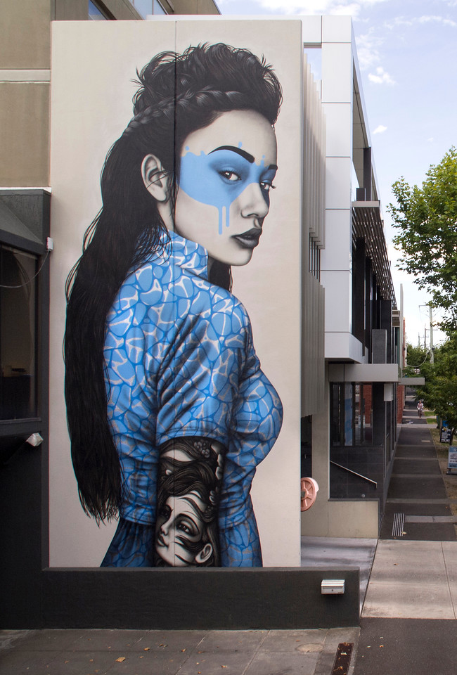 Masked woman in Brighton - Where to find some of the best street art in Melbourne - StreetArtChat.com