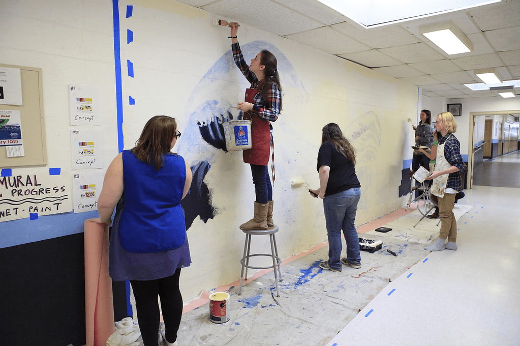 students painting mural at Rockland Maine Oceanside High School