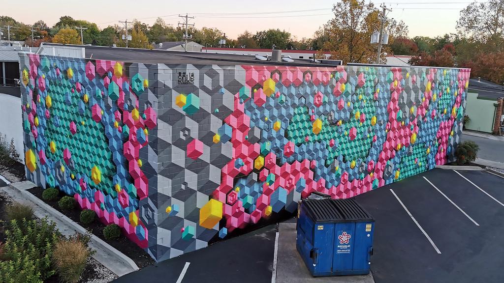 Full building mural - Street Artist Sprite's Inspiring Mental Health Message - StreetArtChat.com
