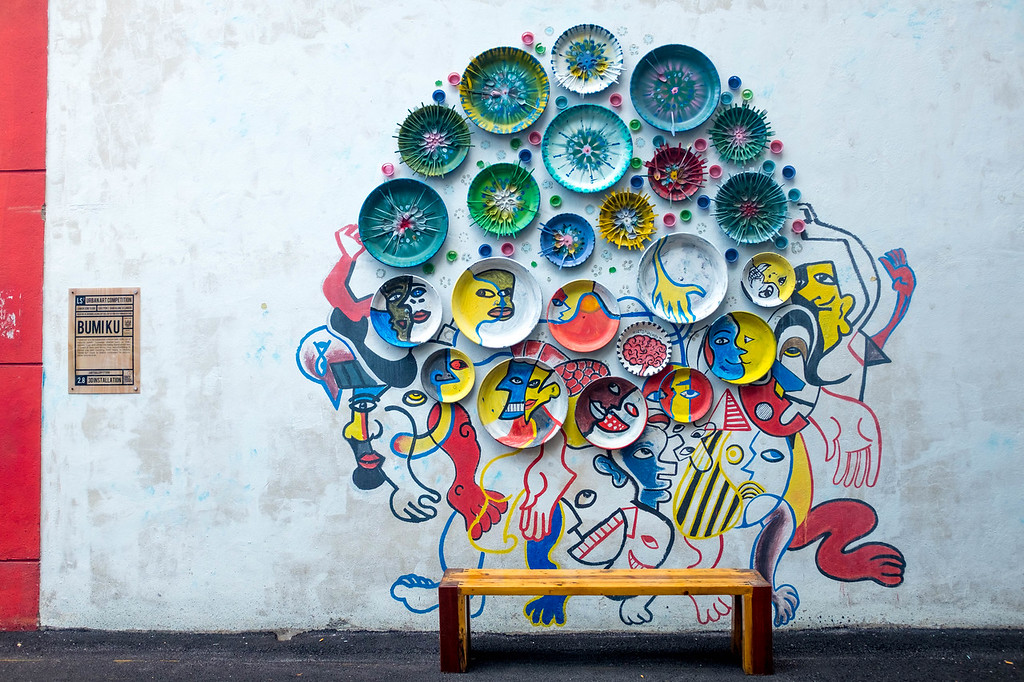 Unknown Artist - Plates on a wall street art